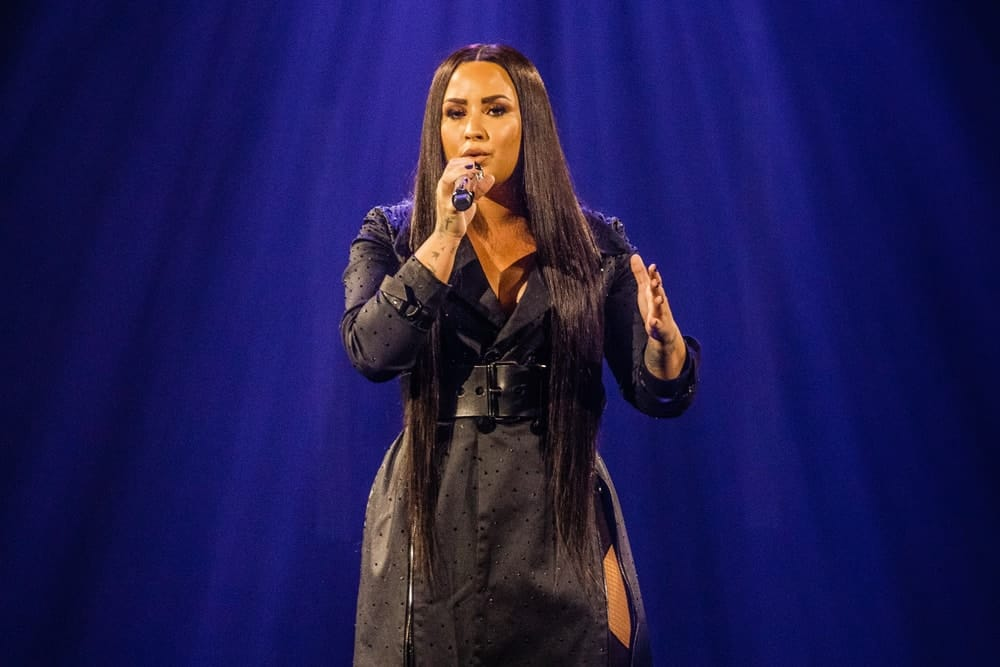 Demi Lovato performed on stage on June 18, 2018 at the AFAS Live in Amsterdam. She wore an all-black outfit that she paired with her super long and straight black hairstyle that reaches all the way to her hips.
