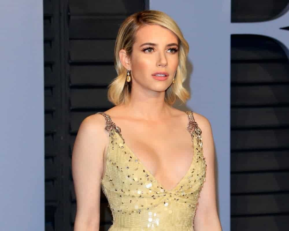 Emma Roberts was at the 24th Vanity Fair Oscar After-Party at the Wallis Annenberg Center for the Performing Arts on March 4, 2018, in Beverly Hills, CA. She was stunning in a golden dress that she topped with a shoulder-length tousled sandy-blonde hairstyle with waves and side-swept bangs.