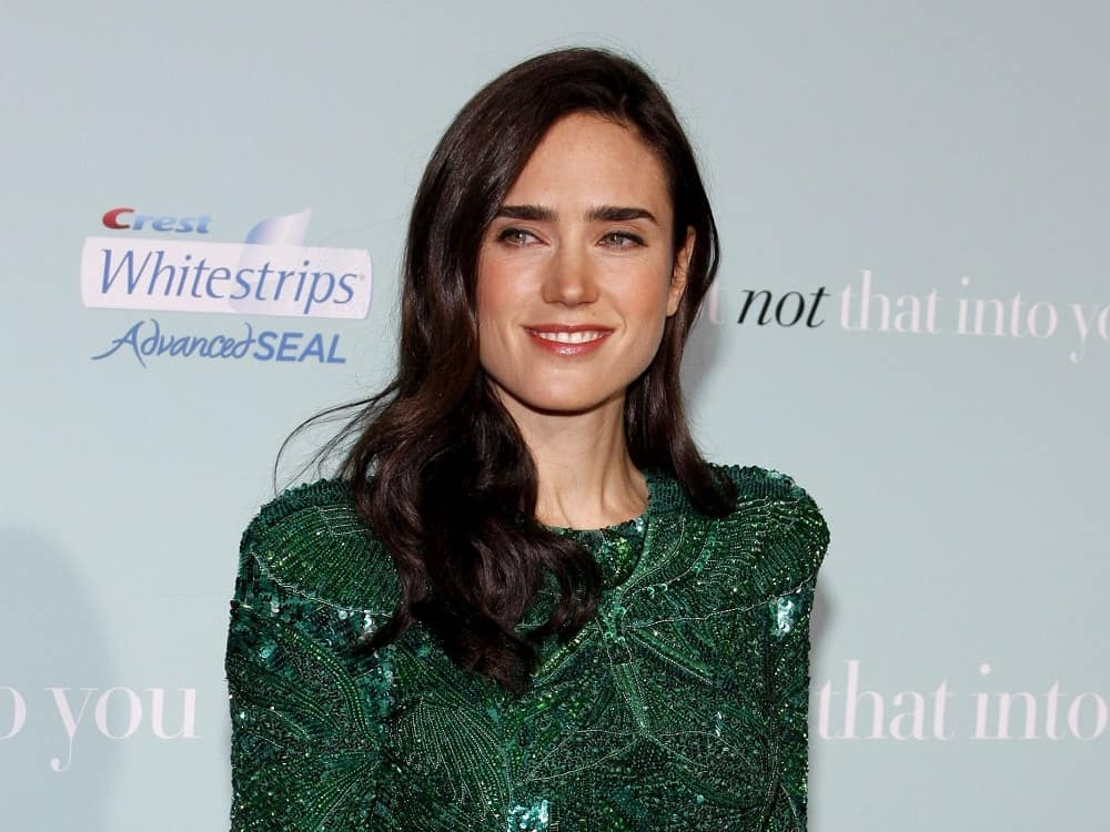 Jennifer Connelly attended the World premiere of 'He's Just Not That Into You' held at the Grauman's Chinese Theater in Hollywood on February 2, 2009. She was seen wearing a green dress with her long and wavy side-swept dark hairstyle with a slight tousle.