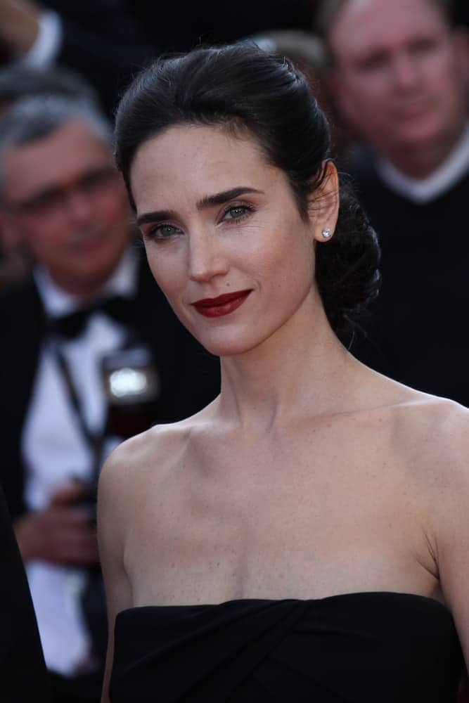 Jennifer Connelly attended the 'Once Upon A Time' Premiere during 65th Annual Cannes Film Festival during at Palais des Festivals on May 18, 2012 in Cannes, France. She paired her black strapless dress with an elegant low bun raven hairstyle with a neat finish.