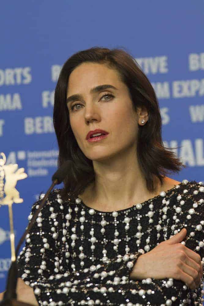 Jennifer Connelly attended the 'Aloft' press conference during the 64th Berlinale Film Festival at Grand Hyatt Hotel on February 12, 2014 in Berlin, Germany. She wore a dress with pearls to pair with her shoulder-length tousled raven hairstyle with layers.