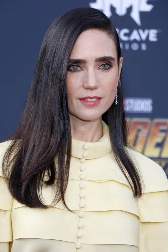 Jennifer Connelly was at the premiere of Disney and Marvel's 'Avengers: Infinity War' held at the El Capitan Theatre in Hollywood on April 23, 2018. She was seen wearing a yellow blouse with her long and tousled dark hair with long side-swept bangs.