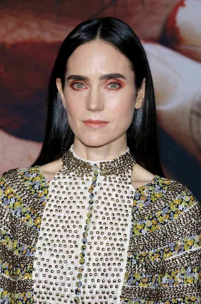 Jennifer Connelly attended the Los Angeles premiere of 'Alita: Battle Angel' held at the Regency Village Theatre in Westwood on February 5, 2019. She paired her detailed dress with a long and silky straight raven hairstyle parted in the middle.