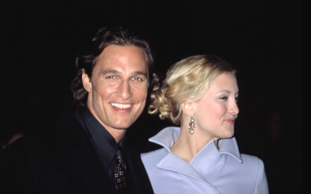 Kate Hudson and Matthew McConaughey were at the premiere of HOW TO LOSE A GUY IN 10 DAYS in New York on February 2, 2003. Hudson wore a lovely blue winter jacket with her blond hair swept up into a messy and curly bun hairstyle with loose tendrils.