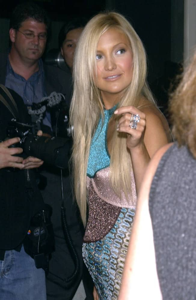 Actress Kate Hudson's's colorful and glittery dress was complemented by her long, layered, straight blond hairstyle loose on her shoulders at the Los Angeles premiere of her new movie Le Divorce on July 29, 2003.