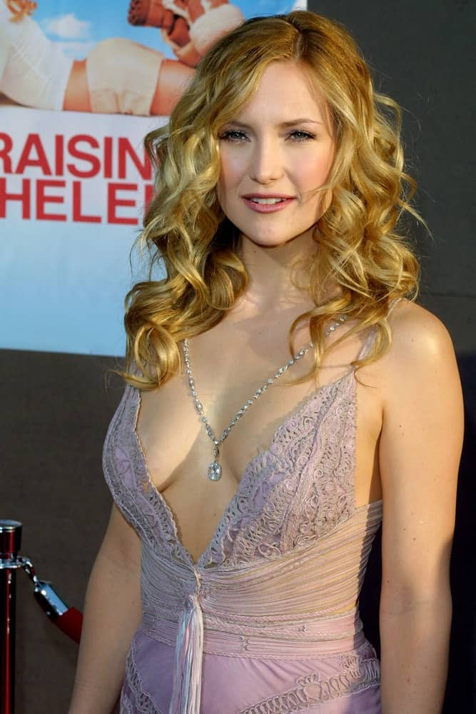 Kate Hudson wore a stunning and sexy dress to go with her tousled sandy blond curls loose on her shoulders at the Los Angeles premiere of 'Raising Helen' held at the El Capitan Theatre in Hollywood, USA on May 26, 2004.