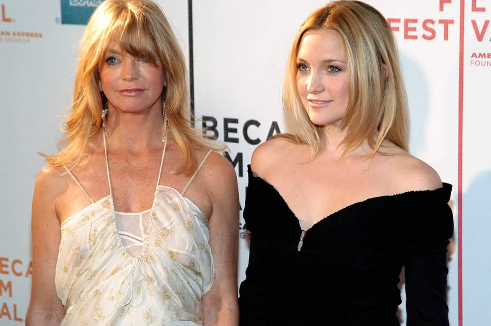 Kate Hudson and her mother attended the screening of RAISING HELEN at the Tribeca Performing Arts Center for the 2004 Tribeca Film Festival on May 1, 2004 in New York City. Hudson wore a stunning black velvet dress that she paired with a long and straight hairstyle with layers.