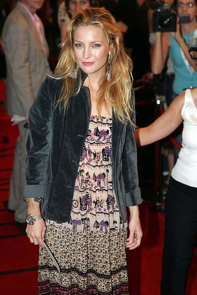 Kate Hudson attended the ELIZABETHTOWN Premiere at the Toronto Film Festival held at the Roy Thomson Hall in Toronto, ON on September 10, 2005. She wore a casual denim jacket with her casual dress and tousled highlighted sandy blond hairstyle.
