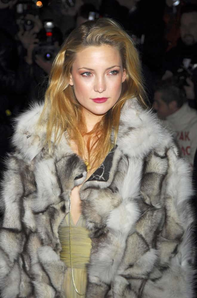 Kate Hudson was at the Versace Fifth Avenue Re-Opening Party, Versace Fifth Avenue Boutique in New York, NY on February 07, 2006. She wore a fashionable fur coat that she paired with a loose and tousled side-swept sandy blond hairstyle with highlights.