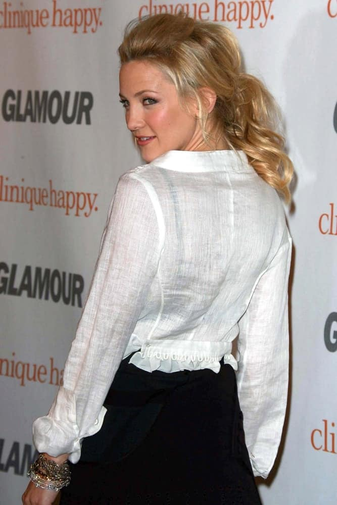 Kate Hudson swept her long wavy blond hair into a beautiful messy low ponytail with loose tendrils and highlights at the 2007 Glamour Reel Moments Party held at the Directors Guild Of America in Los Angeles, CA on October 9, 2007.