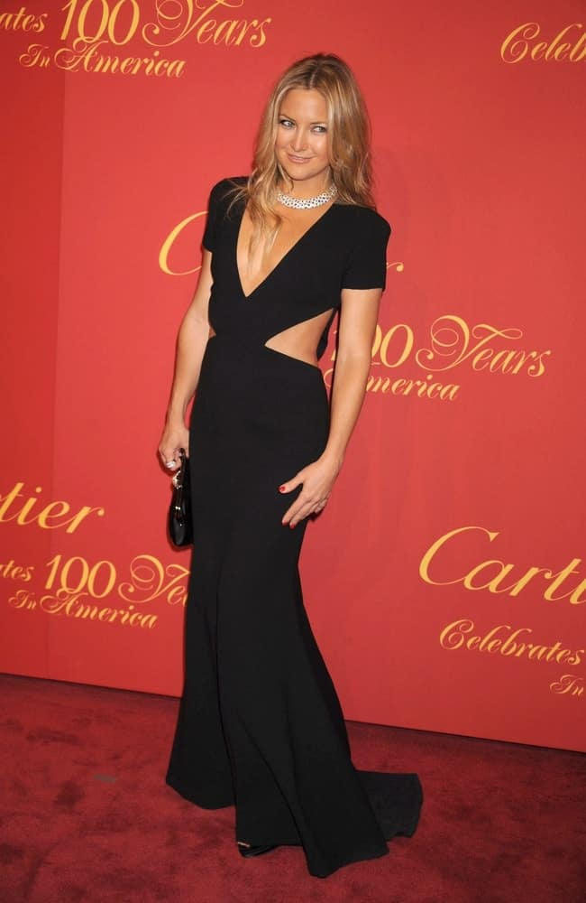 Kate Hudson wore a sexy black Rachel Roy dress with her long and loose layered sandy blond hairstyle with a slight tousle at The Cartier 100th Anniversary in America Celebration, Cartier Fifth Avenue Mansion in New York City, NY on April 30, 2009.