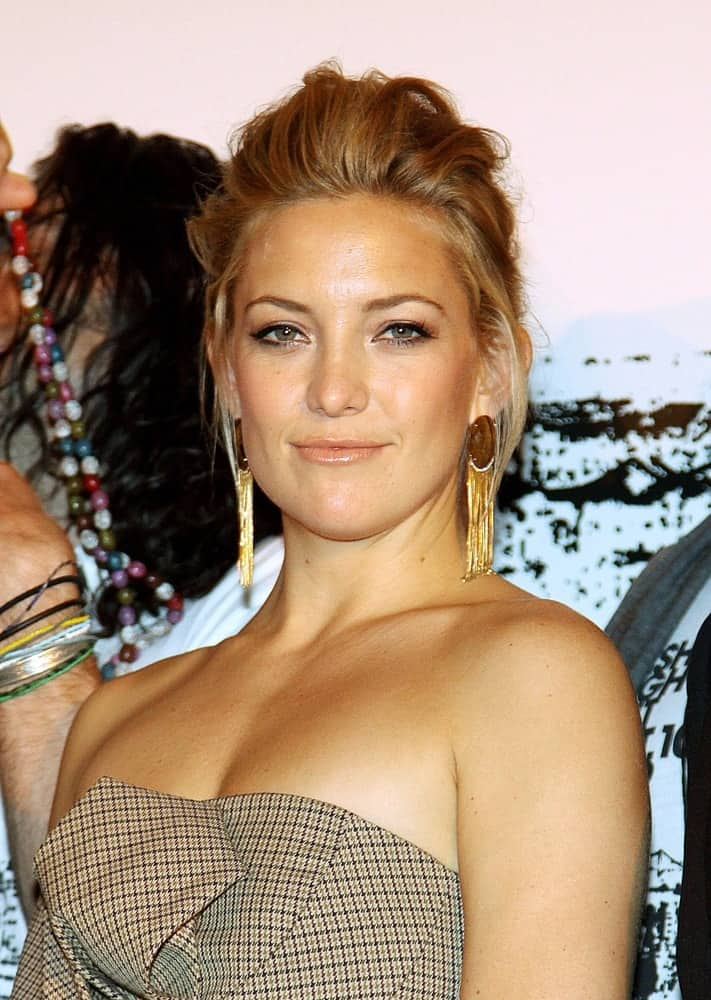 Kate Hudson was at an in-store appearance for FASHION'S NIGHT OUT at Macy's Queens Center, Macy's Queens Center in Queens, NY on September 10, 2009. She wore a strapless patterned dress that she paired with her tousled and highlighted upstyle with loose tendrils.