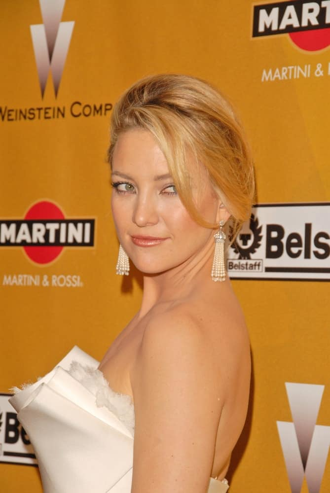 Kate Hudson was at The Weinstein Company 2010 Golden Globes After Party in Beverly Hilton Hotel, Beverly Hills, CA on January 17, 2010. She wore a sexy strapless white dress that she paired with a tousled upstyle that has loose side-swept bangs.