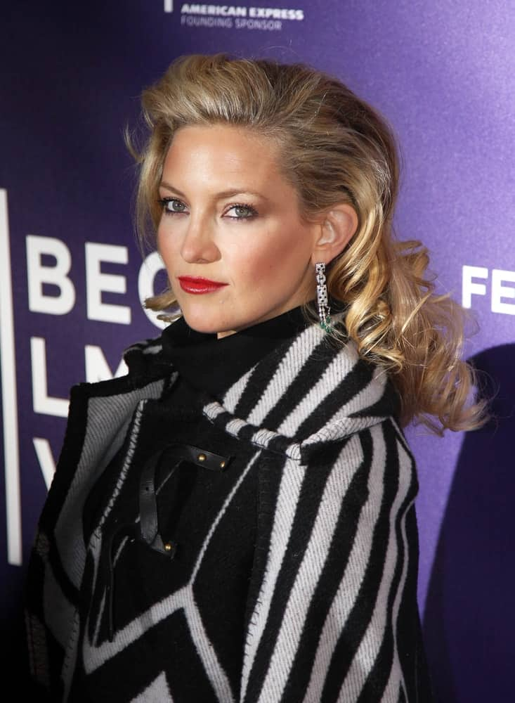 Actress Kate Hudson went with a slight 80's look in her brushed curly blond hairstyle that is perfectly tousled at the premiere of