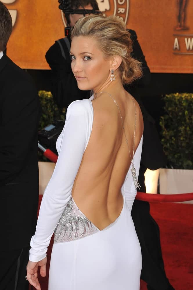 Kate Hudson wore a sexy white backless dress that went perfectly well with her brushed back, tousled and highlighted low bun hairstyle at the 16th Annual Screen Actor Guild Awards at the Shrine Auditorium on January 23, 2010 in Los Angeles, CA.