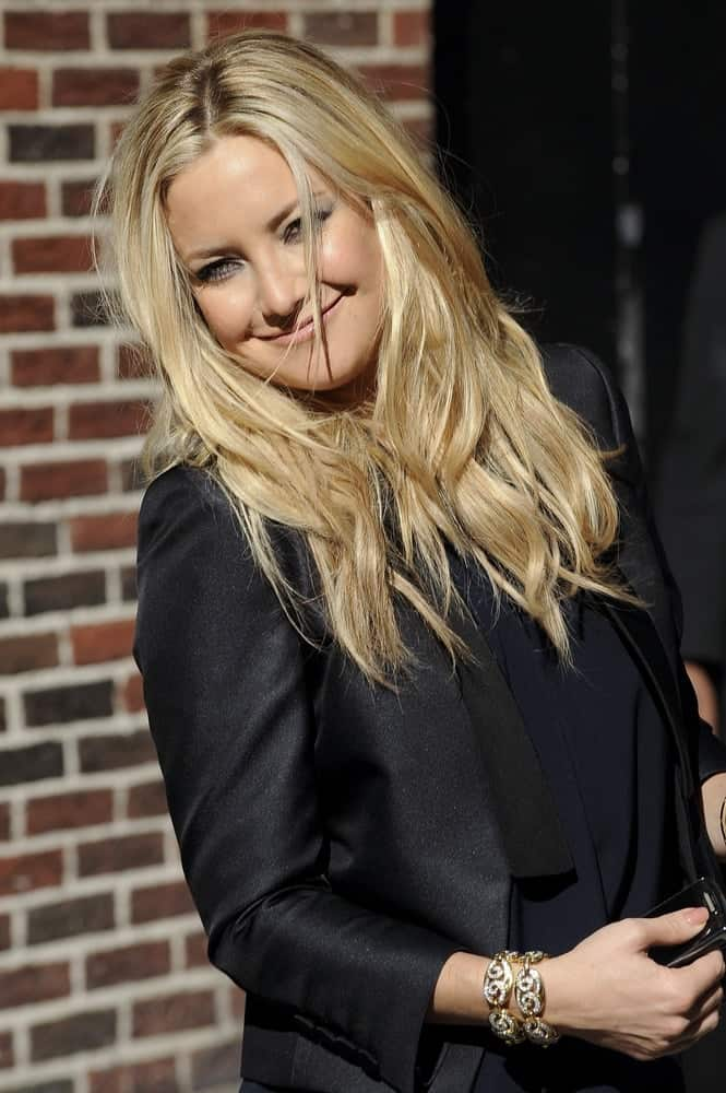 Kate Hudson's long and tousled blond layers stood out on her black smart casual outfit when she visited the 'Late Night With David Letterman' taping in New York, NY on June 8, 2010.
