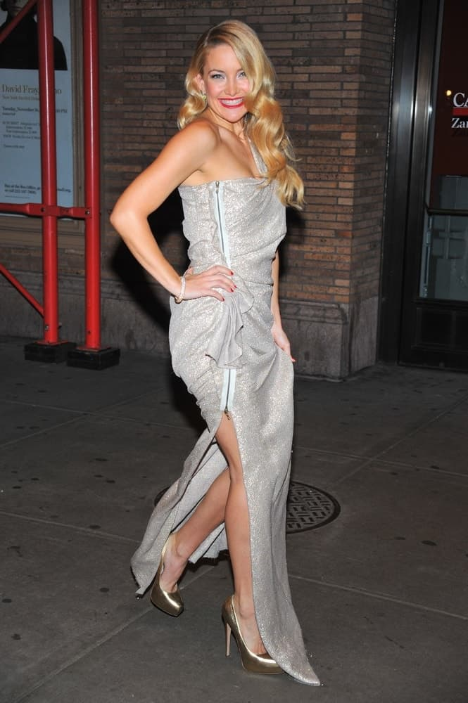 Kate Hudson was seen wearing a silver Lanvin gown, bold red lipstick and side-swept curly sandy blond hairstyle at the GLAMOUR Woman of the Year Awards held at the Carnegie Hall in New York, NY on November 8, 2010.