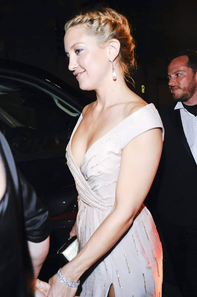 Kate Hudson wore an off-the-shoulder Stella McCartney nude gown at The Mark Restaurant by Jean-Georges in New York City, New York on May 3, 2010. She paired this with a neat and elegant upstyle that is incorporated with braids.