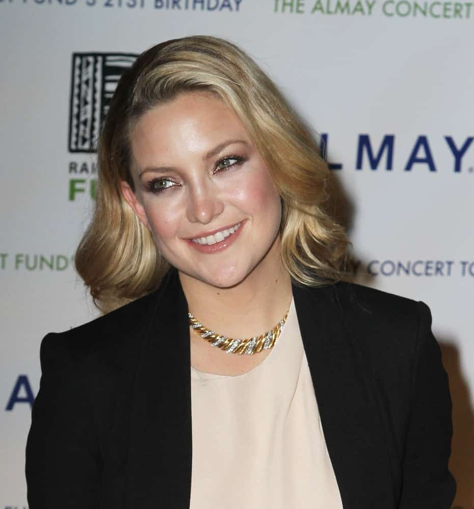 Actress Kate Hudson attended the Almay Concert to celebrate the Rainforest Fund's 21st birthday at the Plaza Hotel on May 13, 2010 in New York City. She wore a simple smart casual outfit that she paired with a shoulder-length sandy blond hairstyle that has elegant curls.