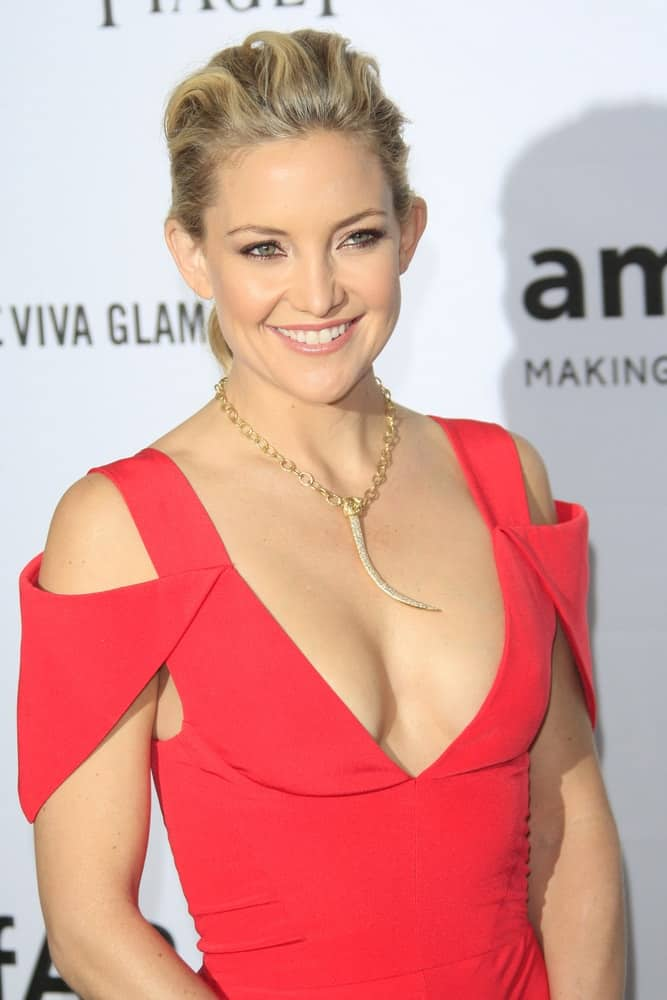 Kate Hudson wore a gorgeous dress that emphasized her sexy figure and tousled low bun hairstyle with highlights at the AMFAR's Inspiration Gala at Milk Studios on October 11, 2012 in Los Angeles, California.