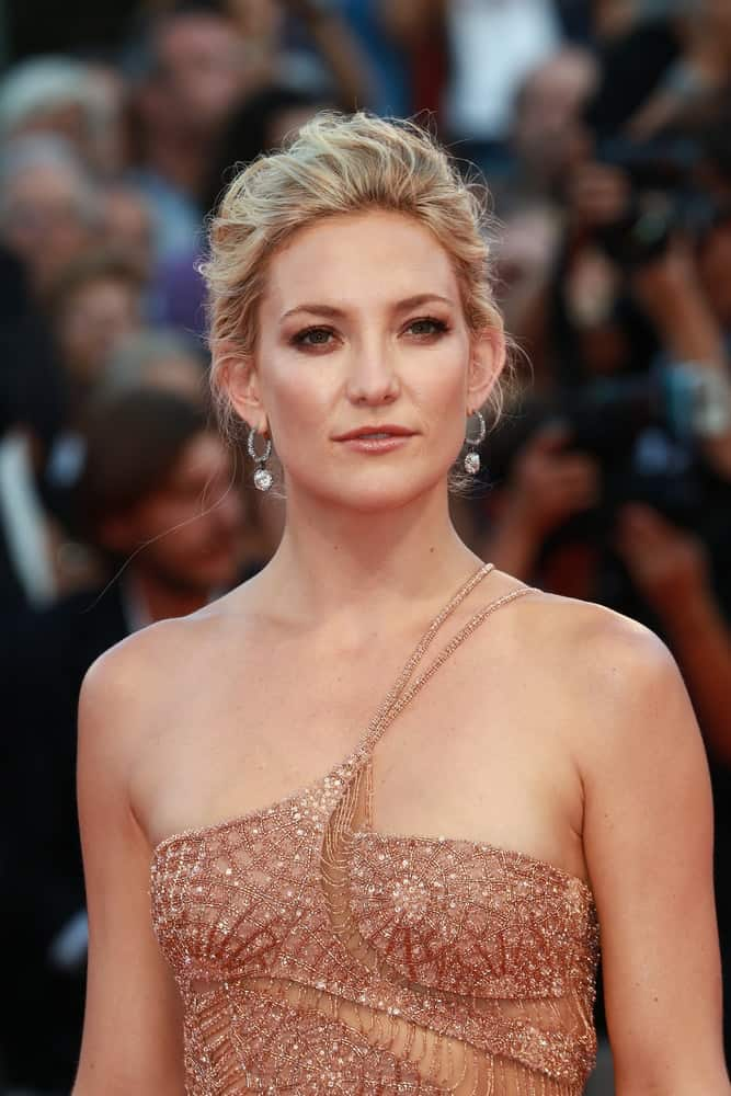 Kate Hudson was quite stunning in her fashionable blush-colored sequined dress and messy bun hairstyle with highlights and loose tendrils at the Venice Film Festival on August 30, 2012 in Venice, Italy.