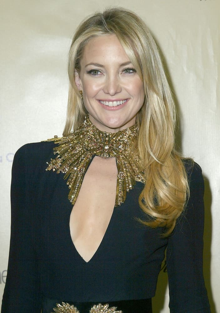 Kate Hudson wore a black dress that she paired with a loose, side-swept layered hairstyle with subtle highlights at the Weinstein Company's 2013 Golden Globes After Party on Sunday on January 13, 2013 at the Beverly Hilton Hotel in Beverly Hills, CA.