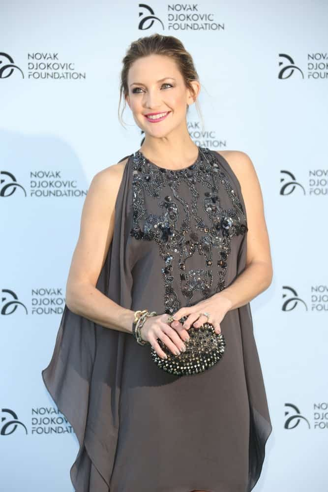 Kate Hudson was at the Novak Djokovic Foundation Event held at the Roundhouse in Camden, London on July 8, 2013. She came wearing a charming gray dress that she paired with a loose and messy bun hairstyle with loose tendrils.