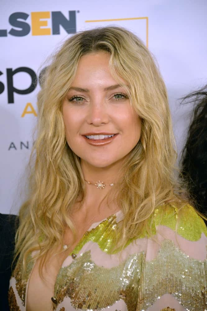 On October 21, 2016, actress Kate Hudson was at the 2016 GLSEN Respect Awards, honoring leaders in the fight against bullying & discrimination in schools, at the Beverly Wilshire Hotel. She came wearing a gold sequined dress with her tousled and wavy blond hairstyle.