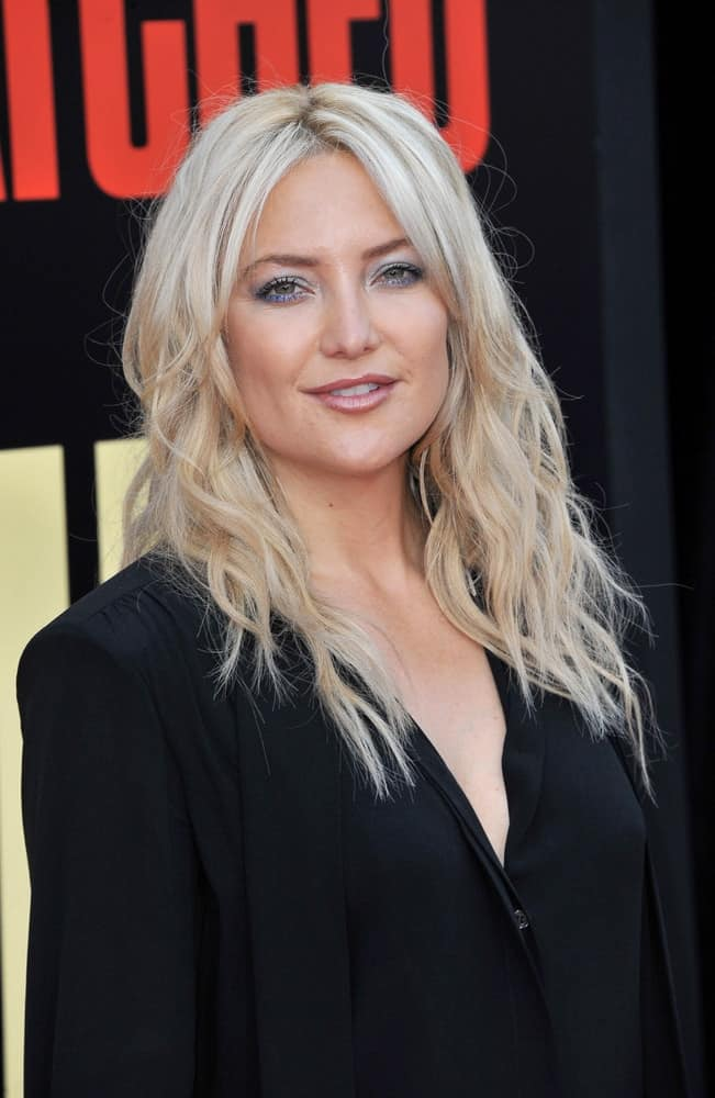 Kate Hudson wore a simple yet charming black blouse that she paired with her long, wavy, tousled blond hairstyle loose on her shoulders at the Los Angeles premiere of 'Snatched' held at the Regency Village Theatre in Westwood, USA on May 10, 2017.