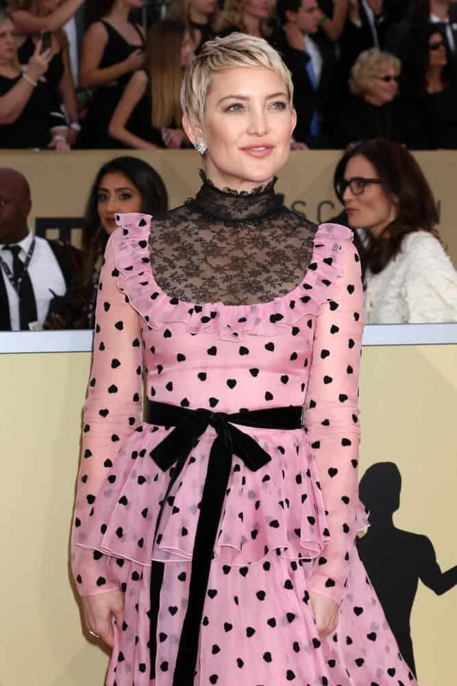 Kate Hudson wowed everyone with her elegant patterned pink dress and highlighted blond pixie hairstyle with short side-swept bangs at the 24th Screen Actors Guild Awards - Press Room at Shrine Auditorium on January 21, 2018 in Los Angeles, CA.