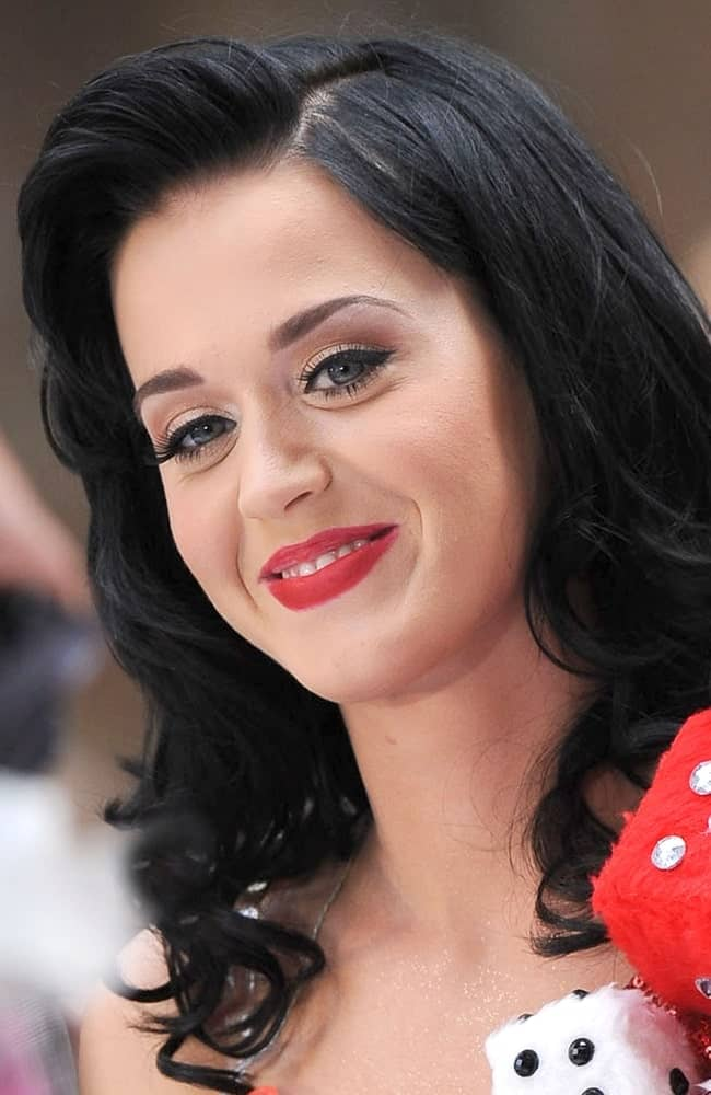 Katy Perry went for glamorous side-swept curls during the NBC Today Show Concert with Katy Perry at Rockefeller Plaza, New York on July 24, 2009.