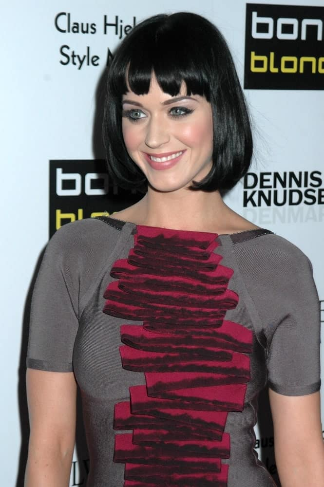Katy Perry flashed a sweet smile at the Bondi Blonde's Style Mansion on February 9, 2009. She wore an edgy dress along with a bob cut and choppy bangs.