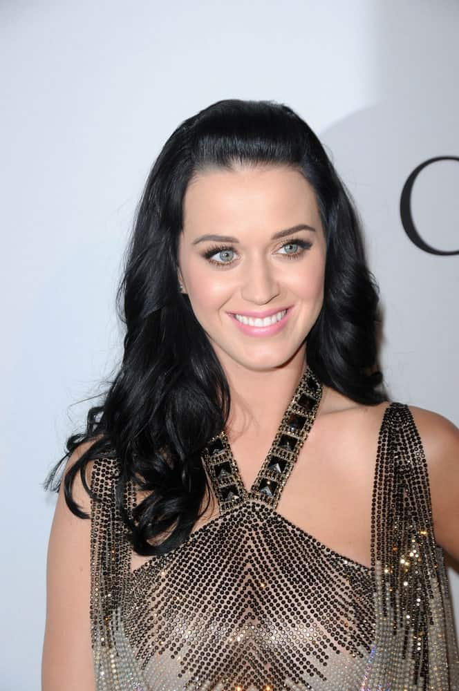 Katy Perry styled her long raven waves in a simple half updo during The Recording Academy and Clive Davis Present The 2010 Pre-Grammy Gala - Salute To Icons on January 30, 2010.