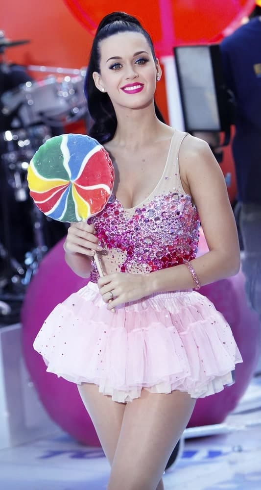 Katy Perry looking sweet as candy with her pink outfit paired with a sky high ponytail as she performs on NBC's