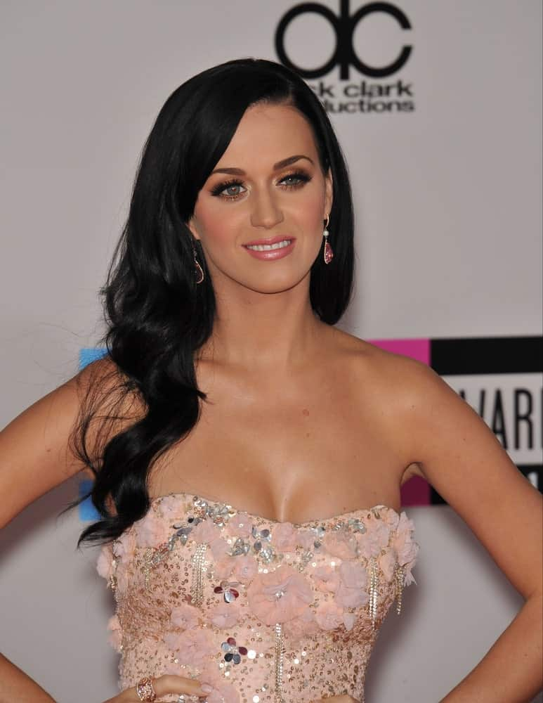 Katy Perry exhibited a charming aura with her long jet black waves at the 2010 American Music Awards at the Nokia Theatre L.A. Live on November 21, 2010.