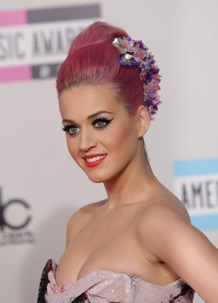 Katy Perry flaunted her slick pink updo decorated with gorgeous accessories at the American Music Awards 2011 in Los Angeles. CA on November 20, 2011.