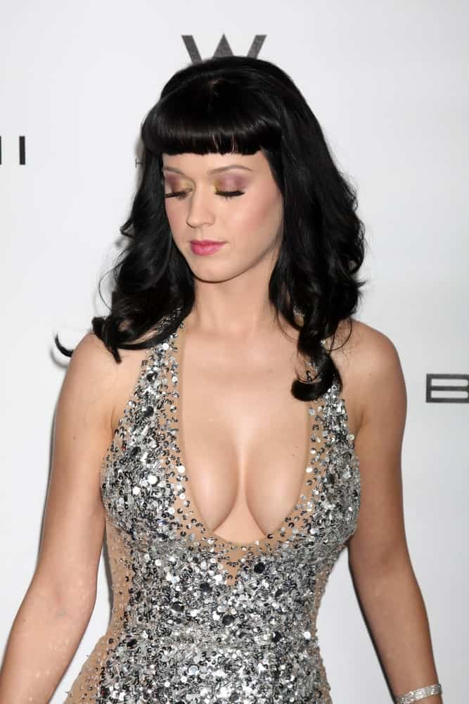 Katy Perry in a sexy gown paired with her black wavy locks that are incorporated with short blunt bangs during the EMI GRAMMY After-Party at Milk Studios on February 13, 2011.