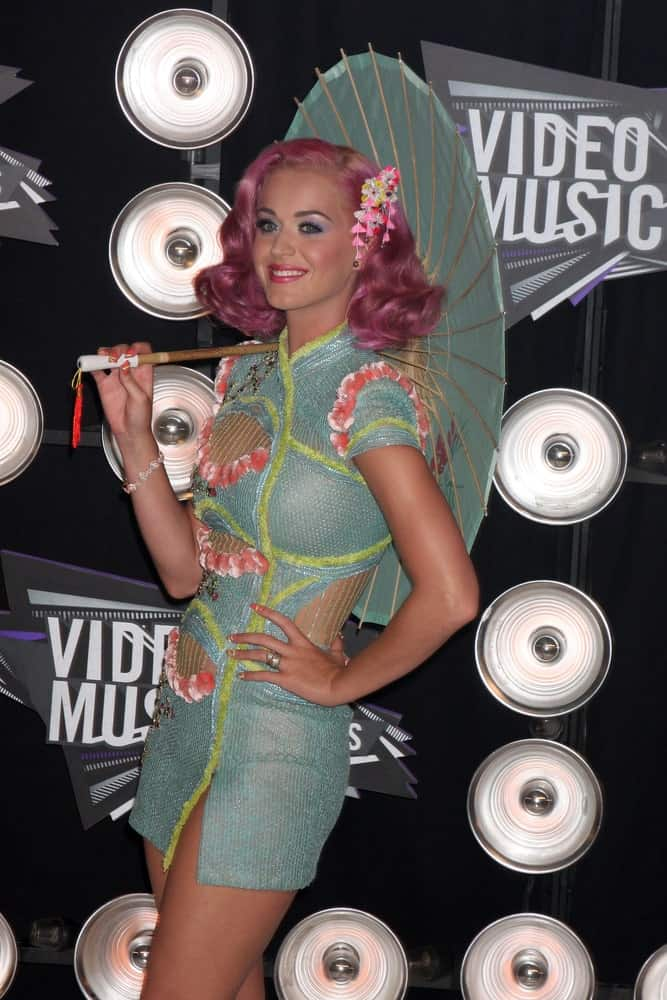 Katy Perry with short curly pink hair complementing her cute outfit at the 2011 MTV Video Music Awards at the LA Live on August 28, 2011.