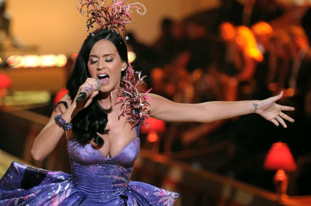 Singer Katy Perry walked the runway during the 2010 Victoria's Secret Fashion Show on November 10, 2010 with her long wavy hair accented with a statement headdress.