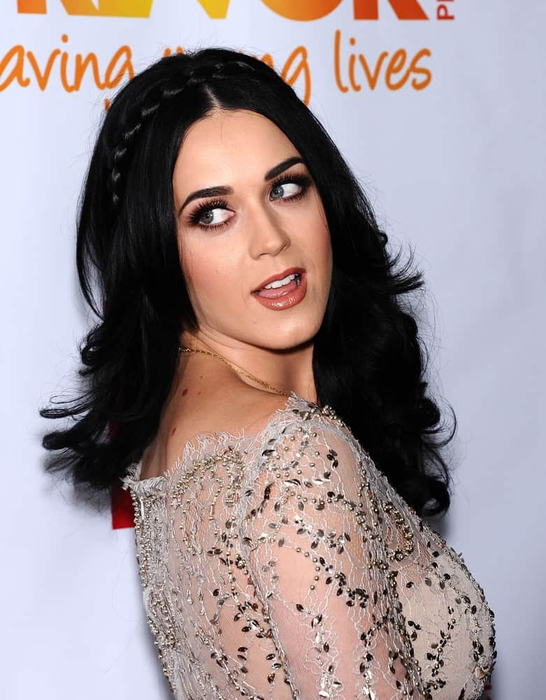 Katy Perry showcased a fab look featuring her long wavy hair incorporated with a braid. This look was worn at the Trevor Project Honors Katy Perry on December 2, 2012.