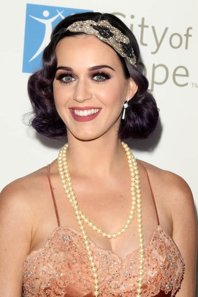 Katy Perry looking glam in short vintage curls incorporated with a classic headband at the City of Hope's Music And Entertainment Industry Group Honors Bob Pittman Event on June 12, 2012.
