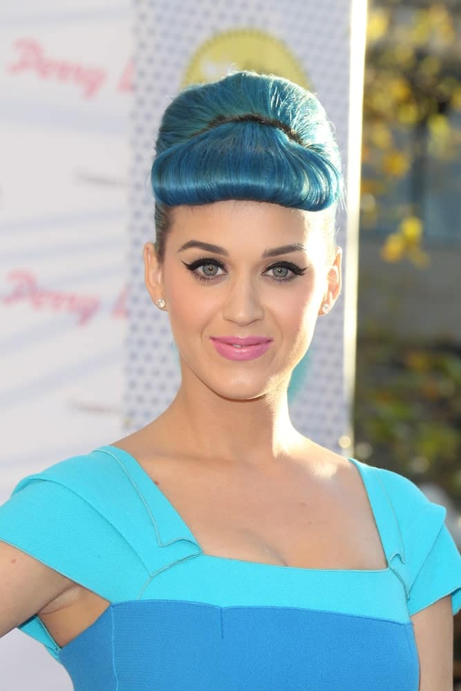 Katy Perry matched her blue outfit with a sleek updo featuring her bumper bangs during the Launch of