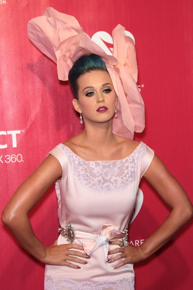 The singer slayed the 2012 MusiCares Person Of The Year honoring Paul McCartney on February 10, 2012 with a cute pink outfit featuring a large floral headdress and her sleek blue upstyle.