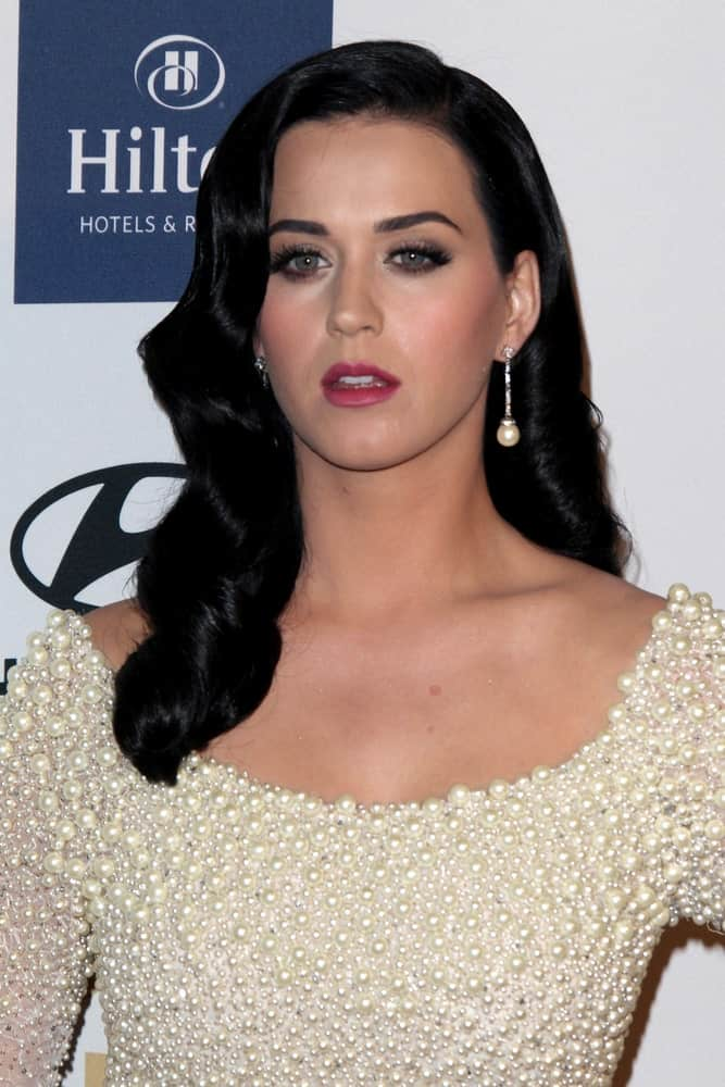 Katy Perry overflowed with posh and class in this beaded gown along with her vintage raven curls during the Clive Davis 2013 Pre-GRAMMY Gala at the Beverly Hilton Hotel on February 9, 2013.