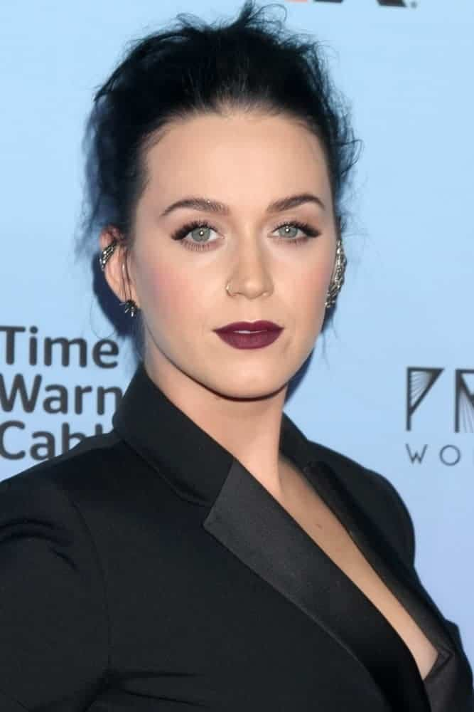 Katy Perry looks sleek in a form-fitting black dress and paired her bold look with a messy upstyle as she attends the Katy Perry: The Prismatic World Tour Premiere.