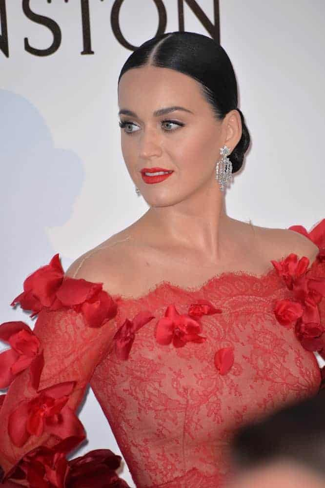 Katy Perry sure made a statement in a red off-the-shoulder petal-embellished gown and she's so sleek and tidy in this low center part bun hairstyle as she attends the amfAR Cinema Against AIDS Gala 2016. For more celebrity hairstyles like Katy, click here!