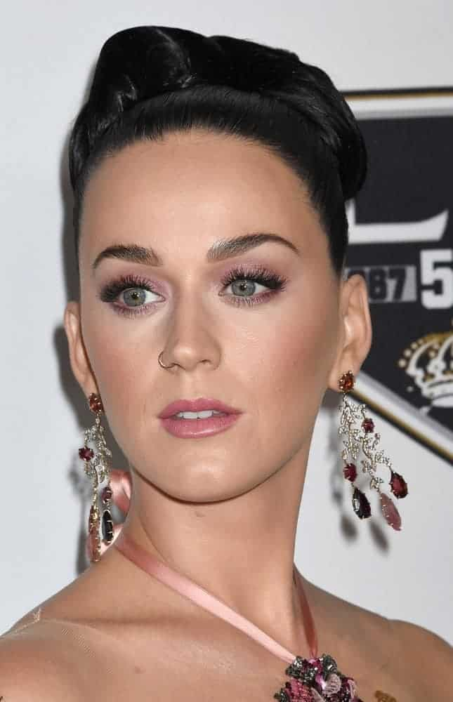 Katy Perry is a golden Goddess in a glittering Champagne off-the-shoulder floral beaded gown and her brunette hair was gathered into an elaborate updo with extravagant earrings to satisfy the audiences at the CHLA Once Upon A Time Gala.