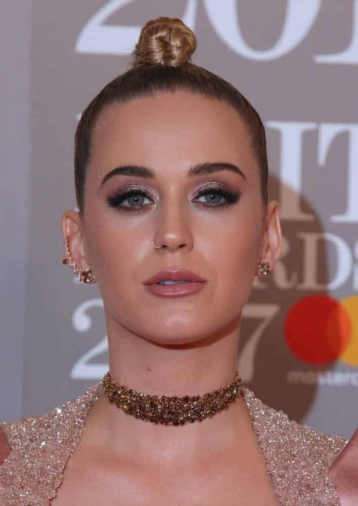 Katy Perry experiments with her blonde locks and styled it with a daring faux-hawk. She oozed glamour in this embellished mini dress with a matching blazer that's certainly made an impression during the 2017 BRIT Awards.