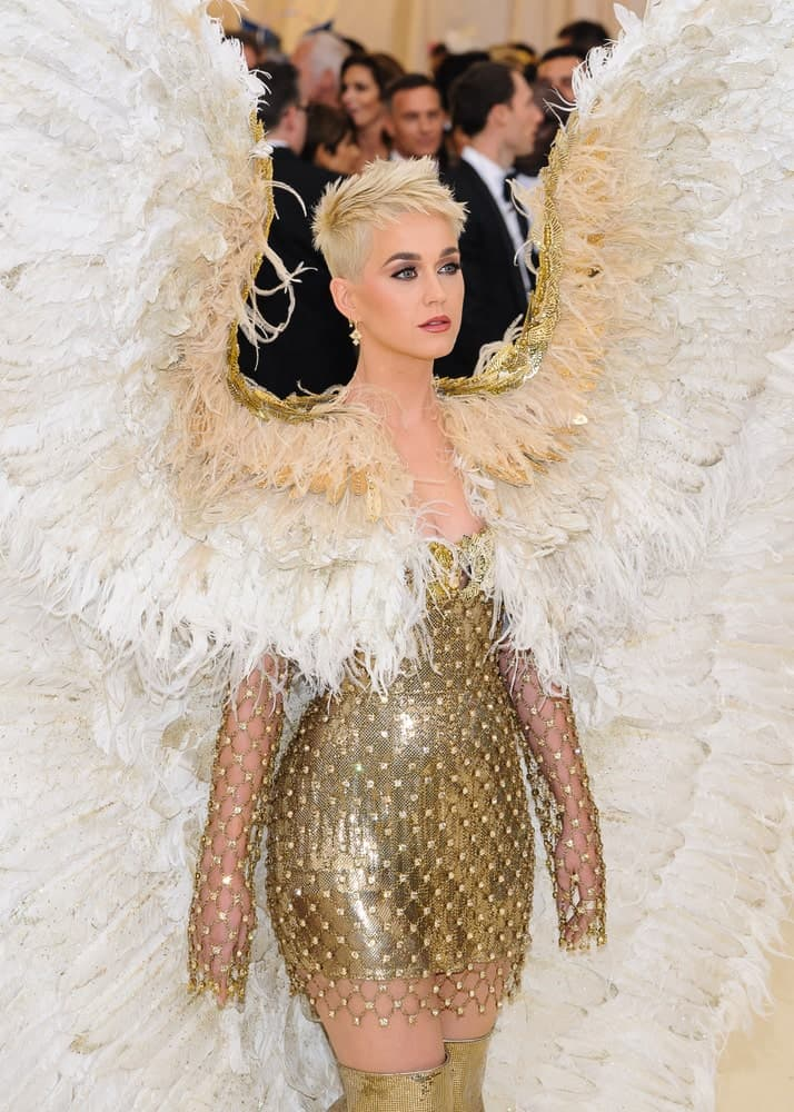 Katy Perry in a gorgeous angel costume along with her feathered pixie cut as she attends the 2018 Metropolitan Museum of Art Costume Institute Benefit Gala on May 7, 2018.