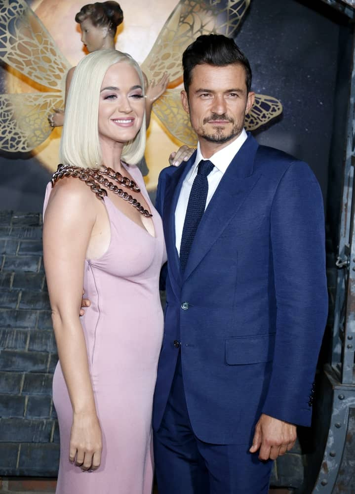 Katy Perry with Orlando Bloom at the Los Angeles premiere of Amazon's 'Carnival Row' held on August 21, 2019. Katy wore a blush dress complemented with her usual straight blonde tresses.
